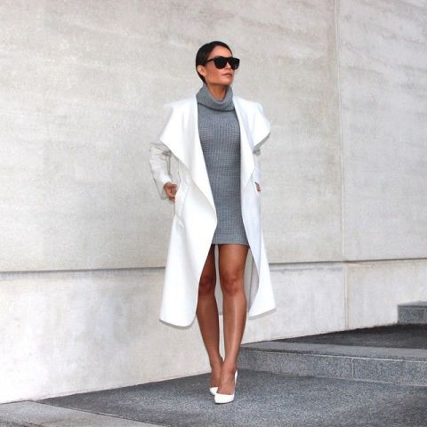 With gray sweater dress and white pumps