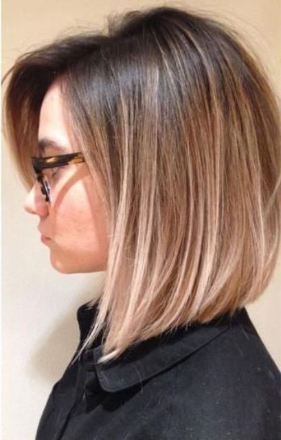 dark brown roots and blonde ombre to accentuate the bob haircut