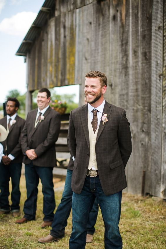 jeans, a white shirt, a creamy waistcoat, a dark brown checked jacket and a polka dot brown tie for a cowboy-style look