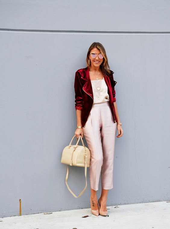 blush cropped pants, a neutral top, a red velvet jacket and nude shoes