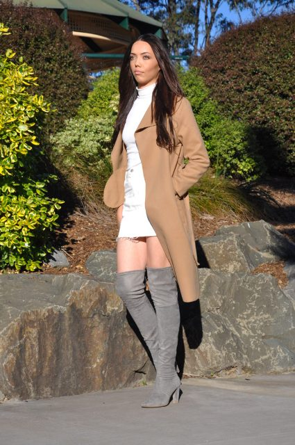 With white shirt, white mini skirt and gray boots