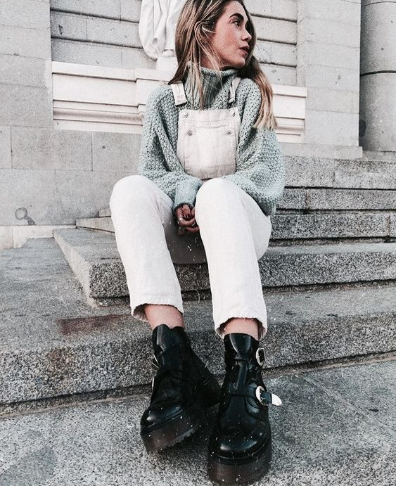 a grey turtleneck sweater, a white denim overal and grunge black boots