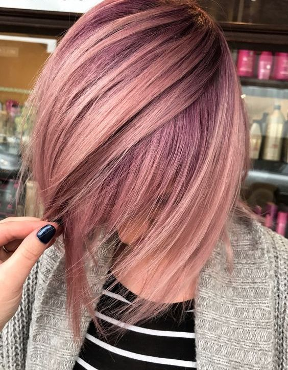 fair hair and rose gold highlights with an angled cut for a bold look