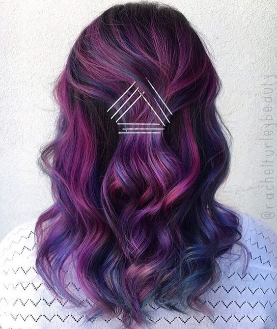 dark brown hair with lots of plum, blue and fuchsia highlights to achieve a super modern look