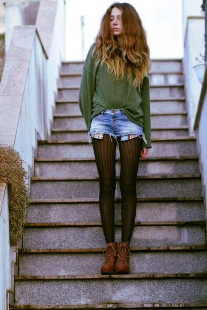 With green loose sweater and brown lace up boots