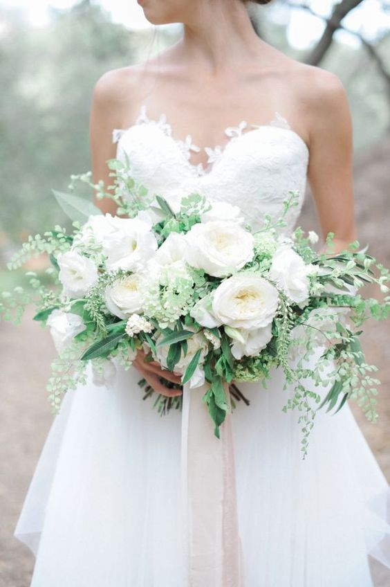 a large elegant white peony and greenery bouquet for a bride who loves classics