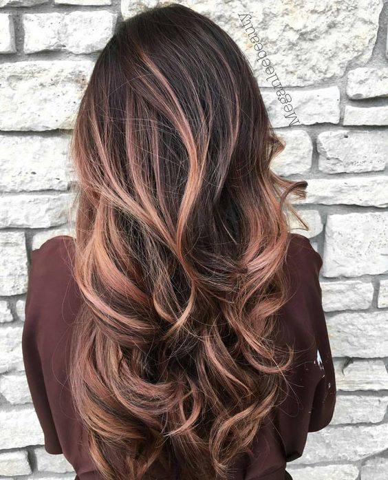 a black root with rose gold balayage looks softer and more refined