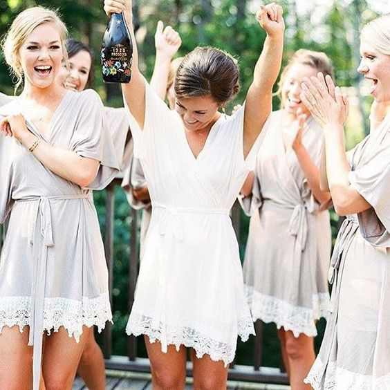 a short white bridal robe with a lace trim and short sleeves is classics