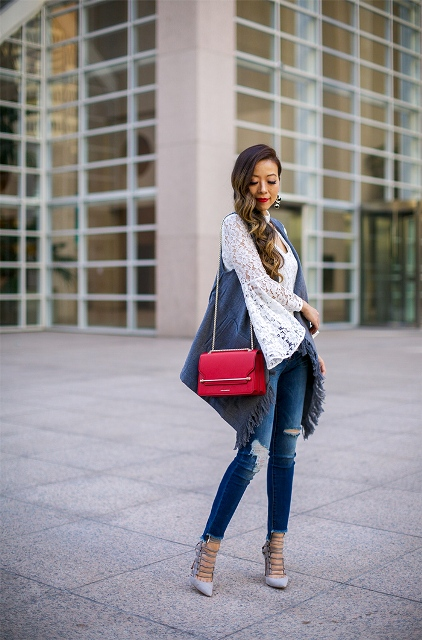 With white lace blouse, distressed jeans, pumps and red chain strap bag