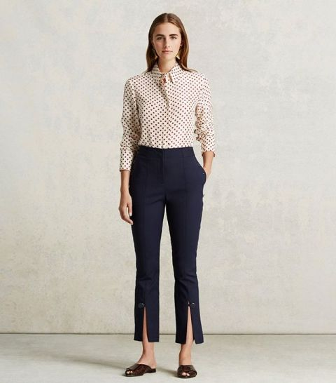 With polka dot shirt and flat sandals