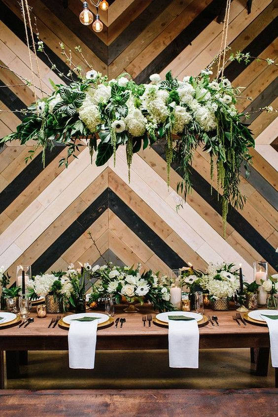 a super lush hanging floral chandelier and a matching table runner