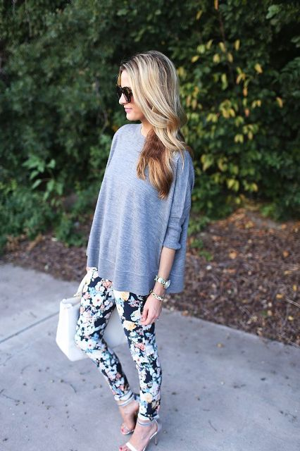 With gray loose shirt, heels and white bag