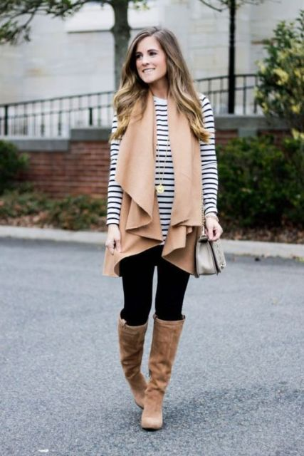 With striped shirt, leggings, brown suede boots and gray bag