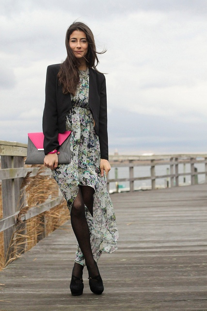 With black blazer, platform shoes and gray and pink clutch