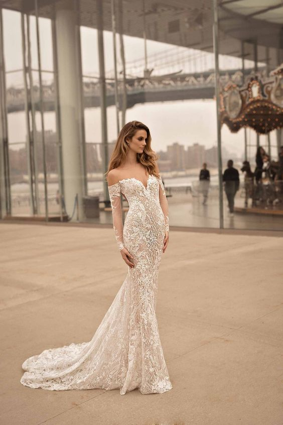 off the shoulder mermaid wedding dress with long sleeves, lace appliques by Berta