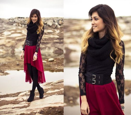 With black lace shirt, belt and ankle boots