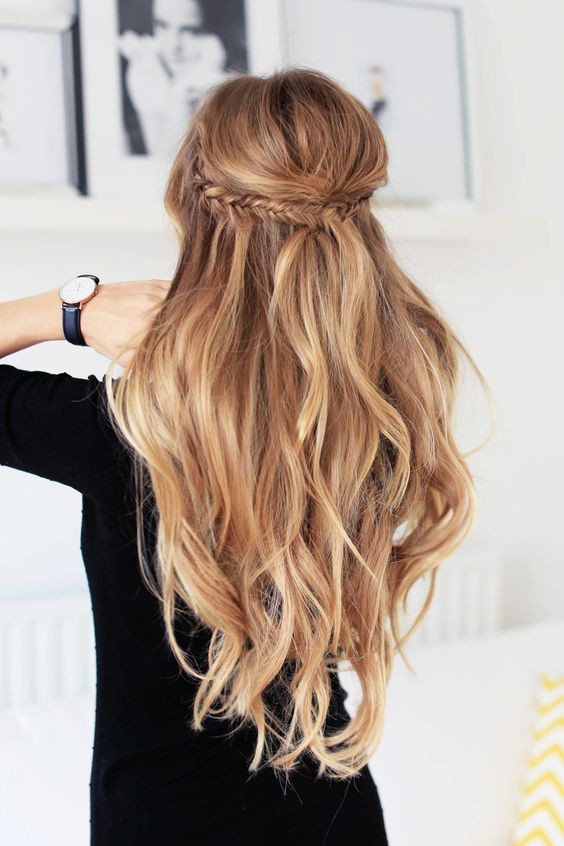 long wavy half updo with a fishtail braid and volume on top for a boho feel