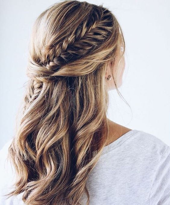 a chic half updo with waves, twists and a fishtail braid going down