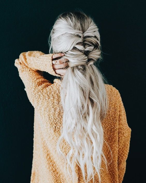 a cool twisted half up ponytail with long waves down for a relaxed wedding