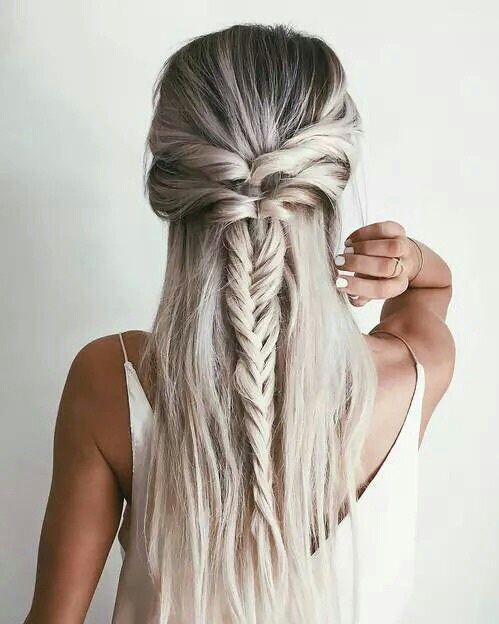 a double twisted half updo with a fishtail braid and straight hair down