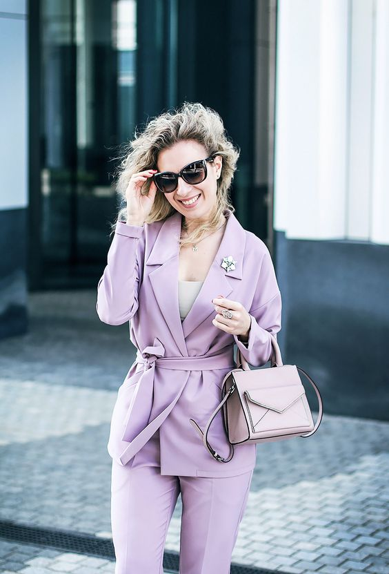 a lilac pantsuit with a neutral top and a blush bag can be worn to the office by romantic girls