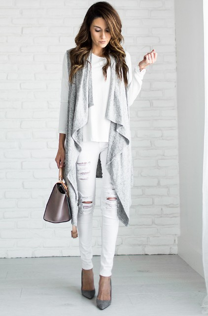 With white shirt, white distressed pants, gray pumps and small bag