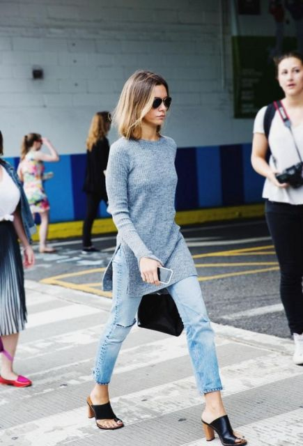 With crop jeans, mules and black bag