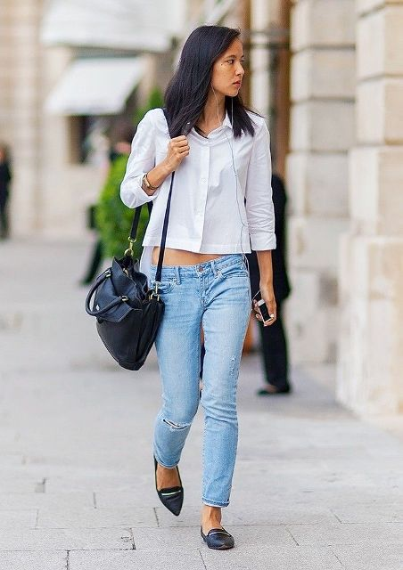 With white crop shirt, jeans and black bag