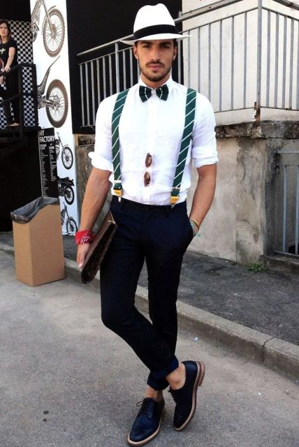 With white shirt, black trousers, black shoes, white and black hat and printed bow tie