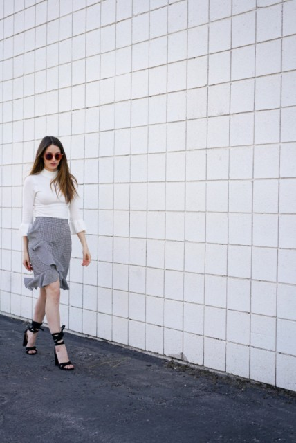With white turtleneck and black high heels