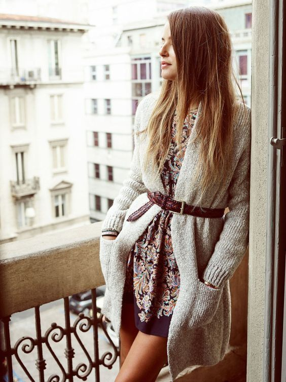 a floral dress, a comfy cardigan with a brown leather belt for a chic look