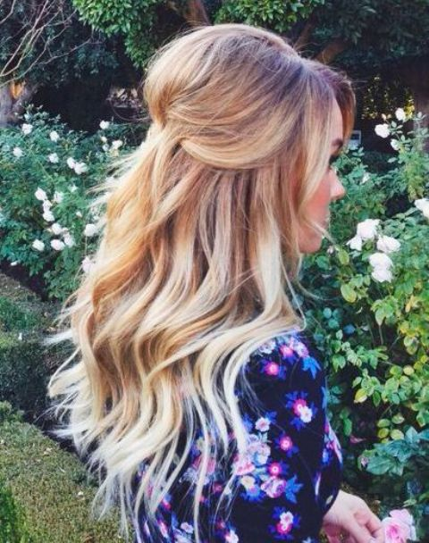 a simple half up half down hairstyle with waves is a classic and timeless option
