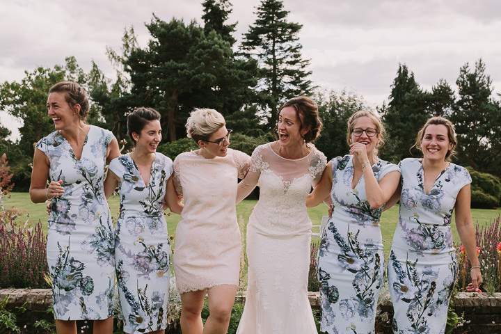 The bridesmaids were wearing midi floral dresses with V necklines