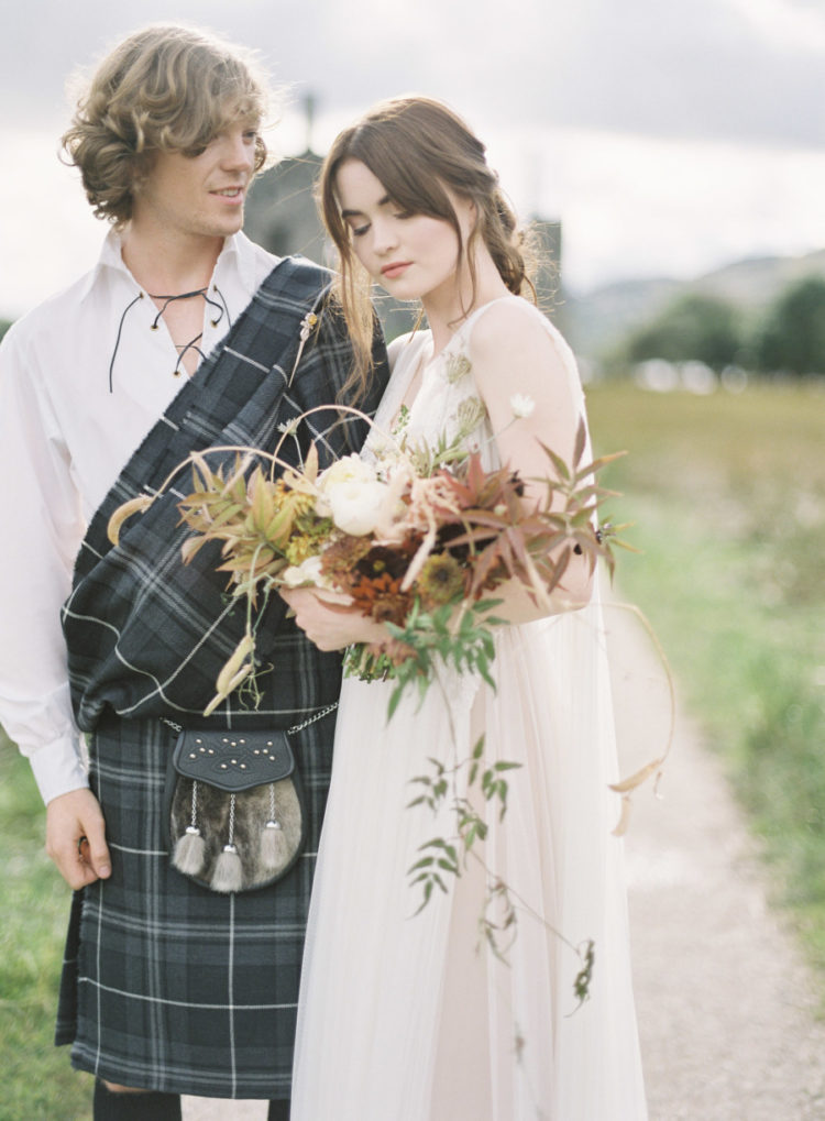 The groom opted for a white shirt with lacing and a traditional kilt