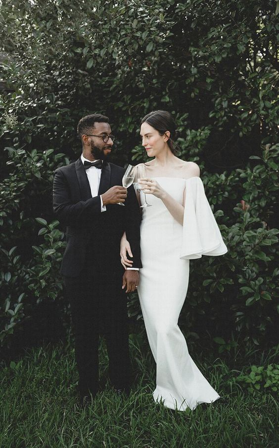 a minimalist wedding dress with off the shoulder bell sleeves to look wow