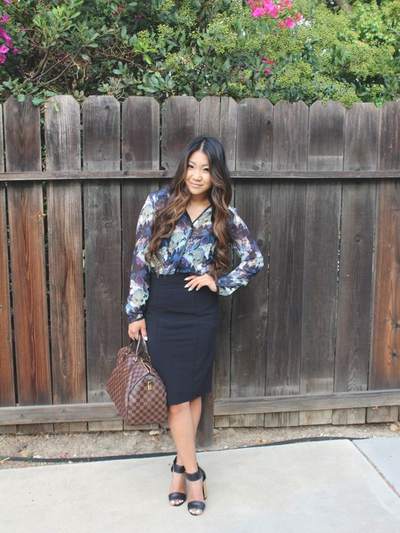 a black pencil skirt, a bold floral blouse, black ankle strap shoes and a brown bag