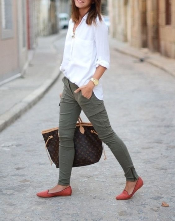 a white shirt, olive green pants, red flats and a printed bag