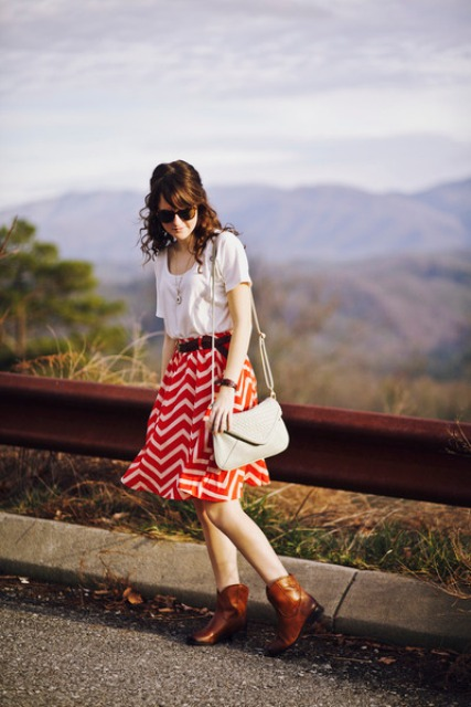 With white t-shirt, beige bag and brown boots