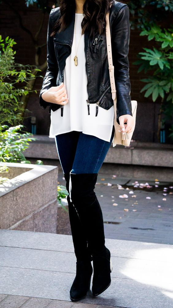 blue skinnies, black suede tall boots, a white pullover and a black leather jacket