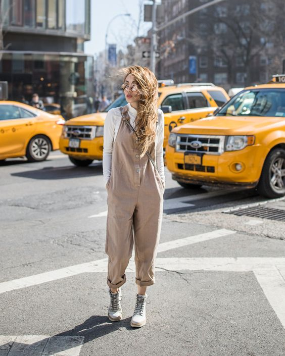 a white turtleneck, a tan loose jumpsuit, grey grunge boots for a super stylish transitional look