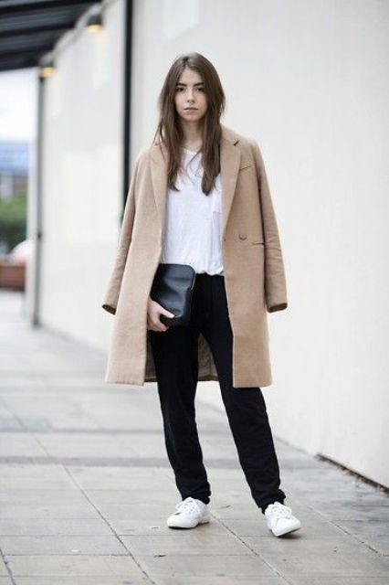 black pants, a white shirt, a tan coat and white sneakers