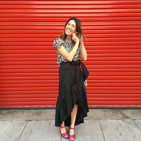 With printed blouse and purple shoes