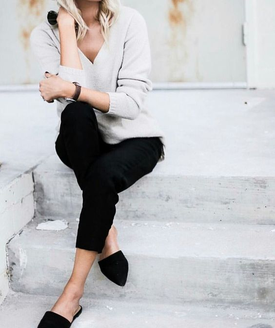 black jeans, black flats, a neutral sweater for a simple office-ready look