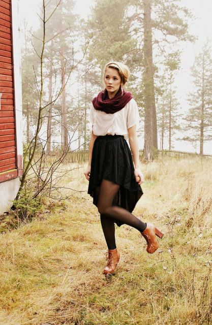With white blouse, marsala scarf, black tights and brown leather boots