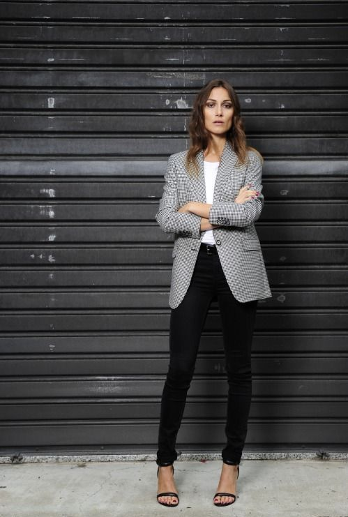 black skinnies, a white tee, a long printed blazer and black heeled sandals for a professional look