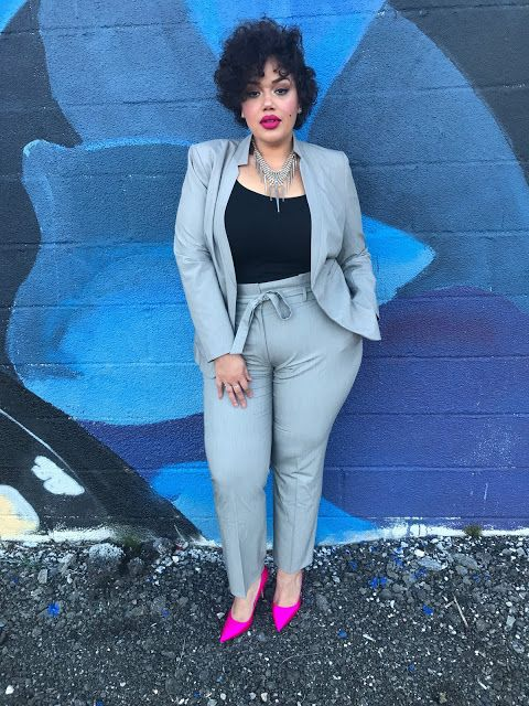 a chic light grey suit with a black top, a statement necklace and hot pink heels for a bold look