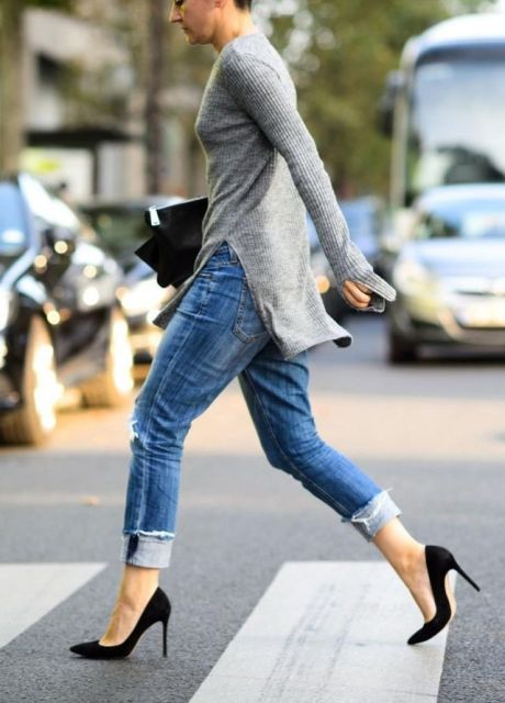 With cuffed jeans, black pumps and clutch