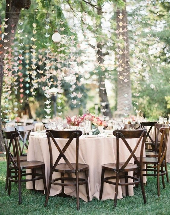 pastel origami crane garlands hanging over the whole reception for a cute look