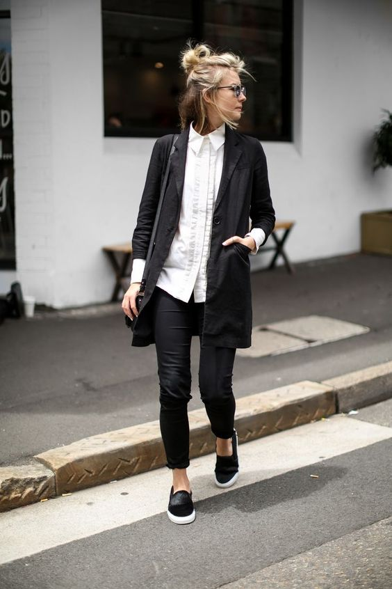 black skinnies, a white long shirt, a black blazer and slip-ons for a casual work look
