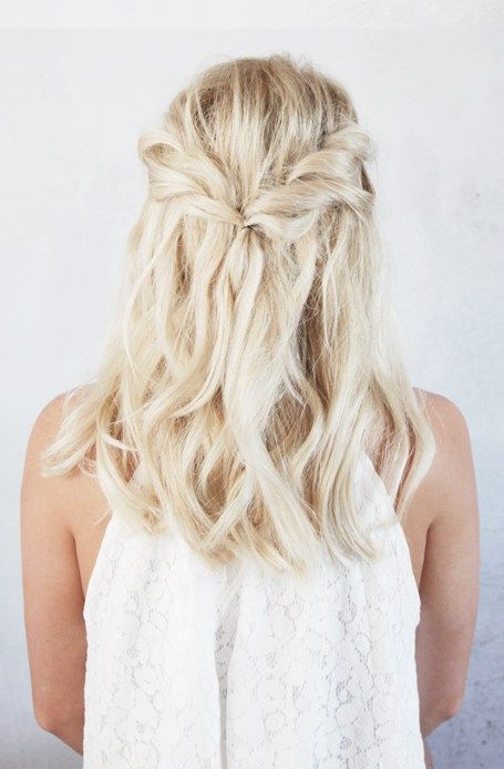 a twisted half-up braid with beach waves is a chic idea for mdeium-length hair and if you don't need anything formal